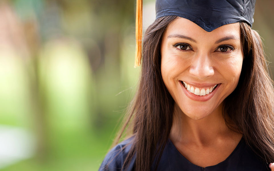 A first-generation student smiles on her graduation day.