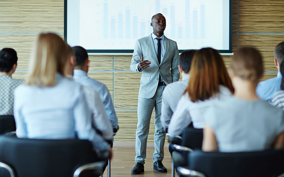 A group of professionals attend a course to obtain necessary credentials.