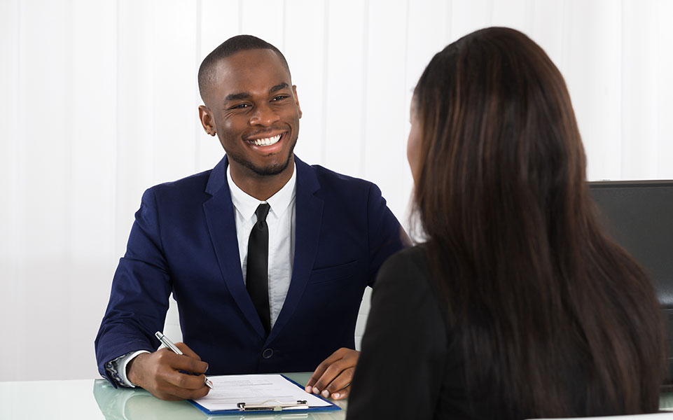 An HR manager discusses the benefits package with a potential intern.