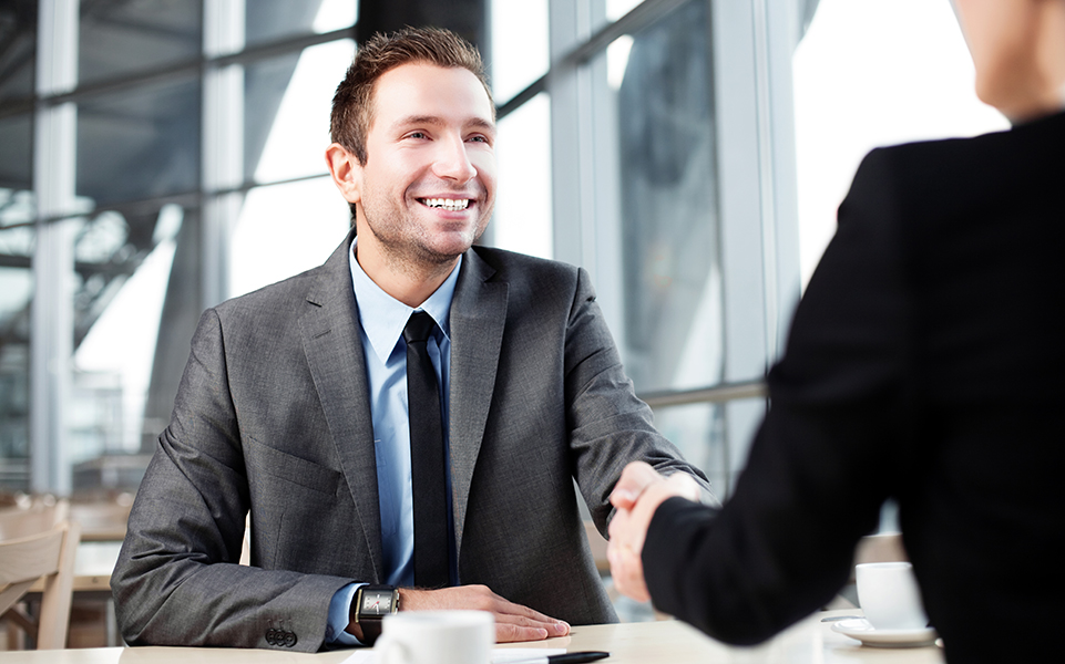 A young man attends a job interview.