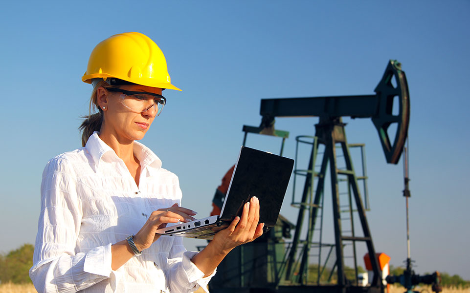 A female petroleum engineer on the job.