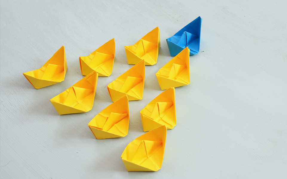 Rows of paper folded into origami shapes.