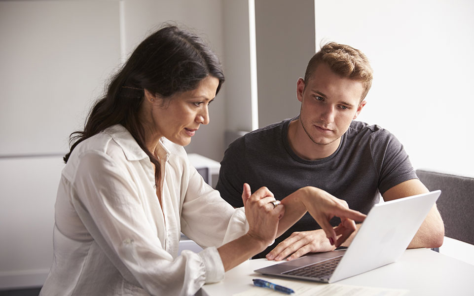 A college student works with a career counselor.