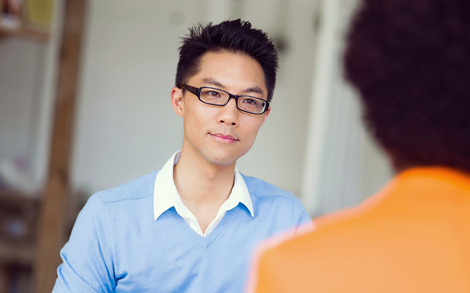 A university relations and recruiting professional interviews a recent college graduate.