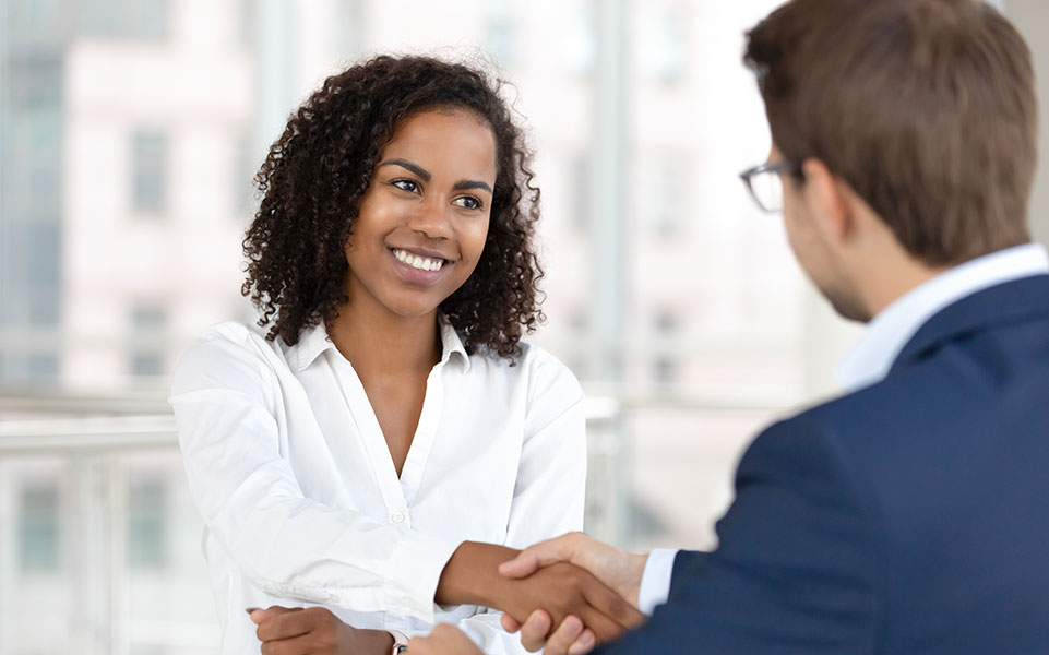 A hiring manager interviews a job candidate.