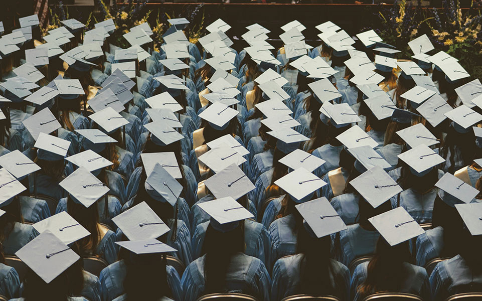 A sea of graduation caps.