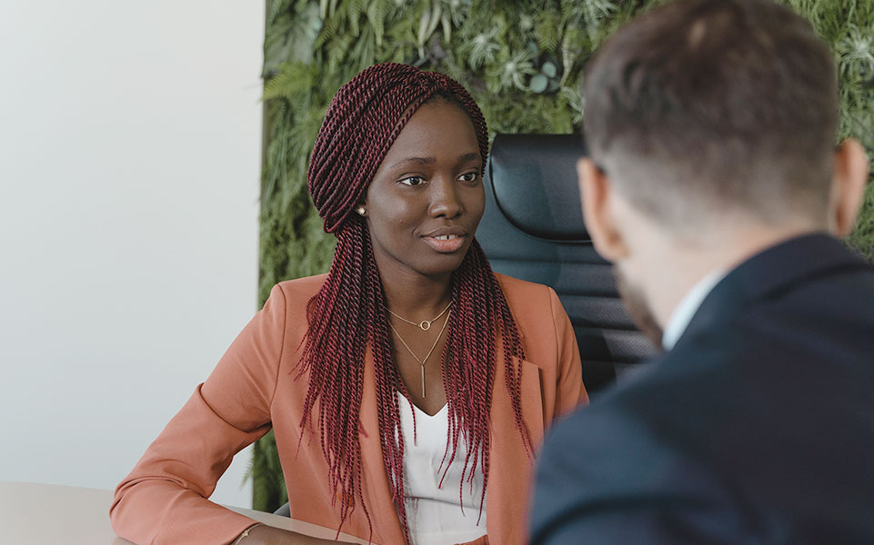 A black, female student inquires about the diversity and inclusion efforts of a potential employer.