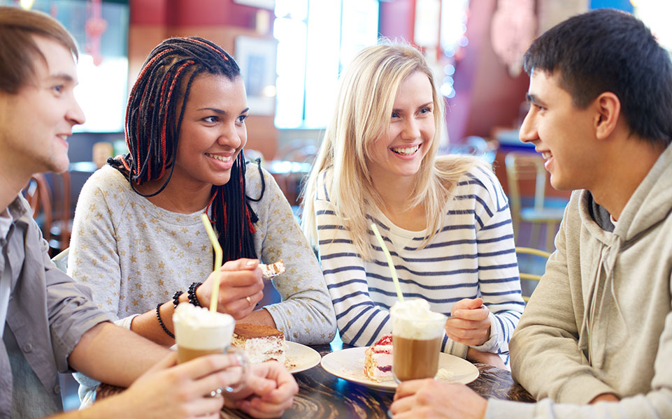A group of college students attend a casual meetup at a local coffee shop to discuss their career development.